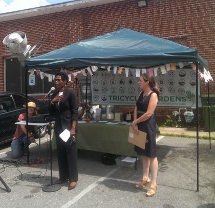 Councilwoman Cynthia Newbille and Tricycle Gardens' Director offer welcome remarks at the launch of Fine Foods participation in the Healthy Corner Store Initiative.