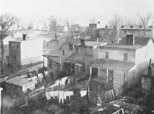 """Rear view of Negro homes on Center Street in Fulton, Richmond.""  via"